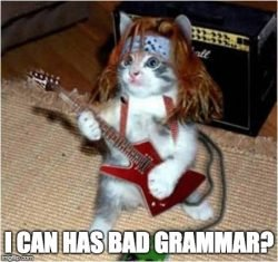 "Cat playing guitar saying, ""I can has bad grammar?"""