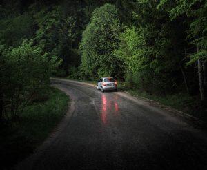 Car traveling along road at night